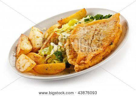 Fish dish - fried fish fillets, baked potatoes and vegetable salad