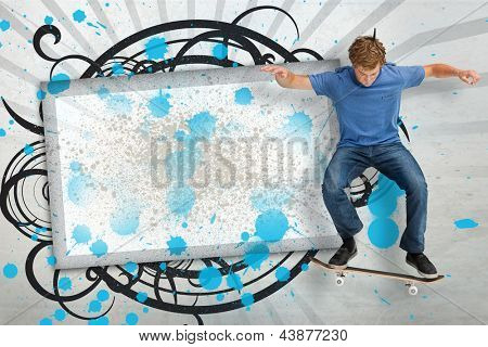 Skateboarder mid ollie in front of copy space screen with blue paint splashes and black decorative frame