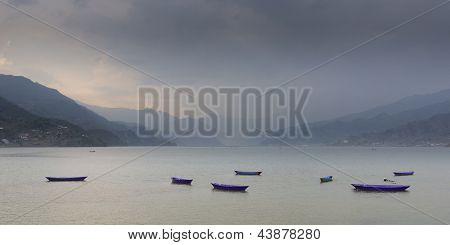 Boats on Phewa lake in Pokhara, Nepal