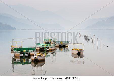 Pedalos on Phewa lake in Pokhara, Nepal