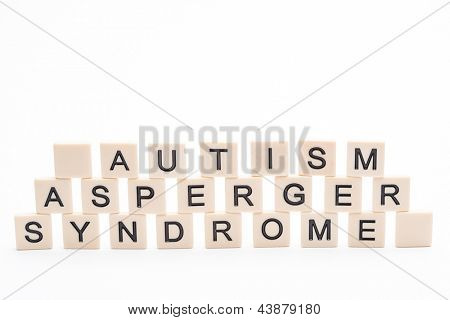 Autism asperger syndrome spelled out in plastic letter pieces on white background