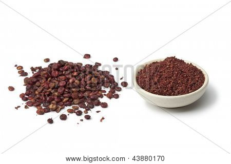 Ground Sumac and  berries on white background