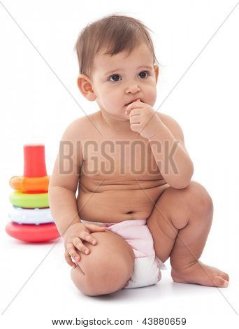 11 monthes baby with thoughtful expression in her face.