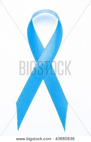 Blue awareness ribbon on white background