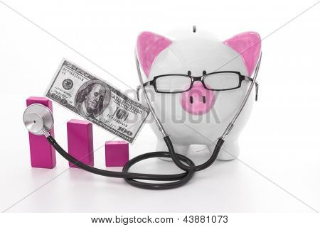 Pink and white piggy bank wearing glasses and stethoscope listening to graph model