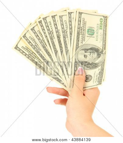 Female hand with dollars, close up, isolated on white