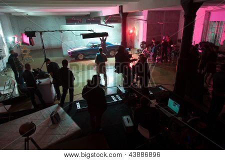 MOSCOW - OCT 23: Director, staff and actors on the set of the video singer Rene. Scene with the car on October 23, 2010 in White studio, Moscow, Russia.