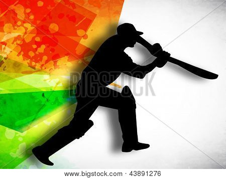 Silhouette of cricket batsman in playing action on colorful grungy background.