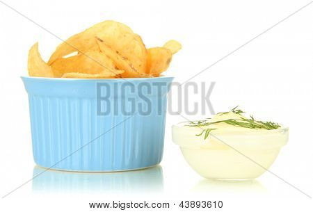 Potato chips in bowl and sauce, isolated on white