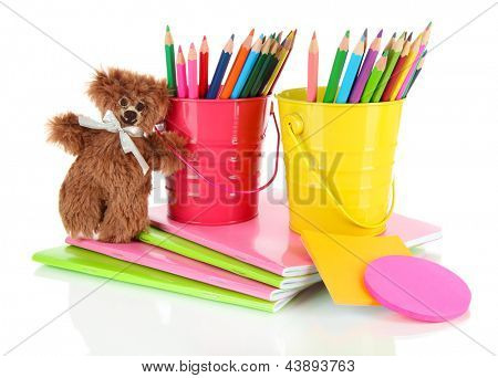 Colorful pencils with school supplies isolated on white