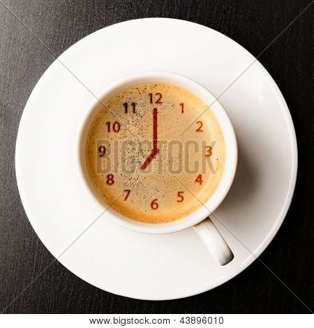 clock. cup of fresh espresso with clock sign, view from above