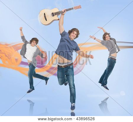 Three of the same young man jumping for joy one holding a guitar with orange and purple smoke trail on blue background