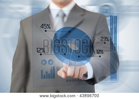 Businessman using blue pie chart futuristic interface with his finger