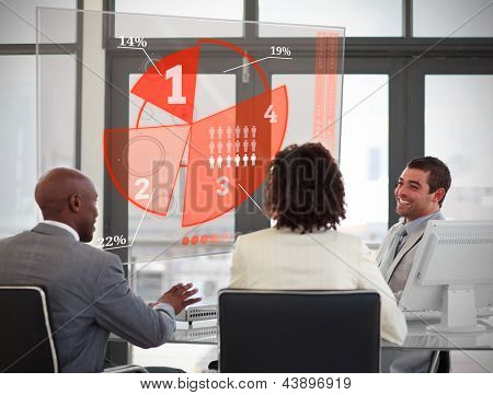 Business people using red pie chart interface in their meeting