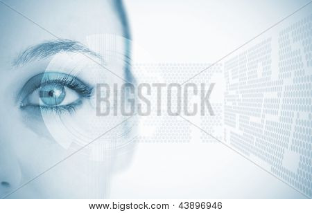 Close up of woman eye in blue with futuristic background showing abstract pattern