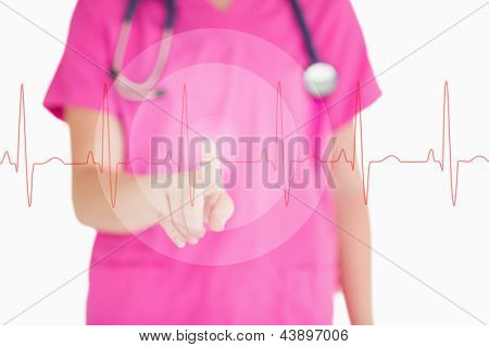 Nurse in pink scrubs touching red ECG line on white background