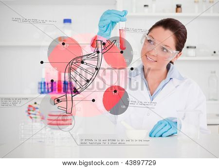 Smiling scientist examining test tube with dna helix holographic interface