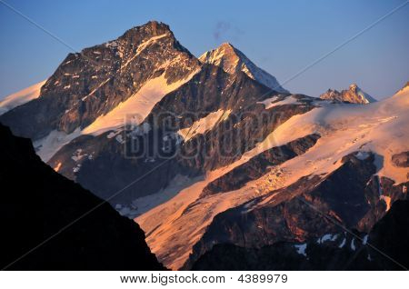 Grand Cornier; Weisshorn And Zinal Rothorn At Sunset