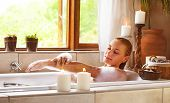 Sensual woman in bathtub relaxed, female in jacuzzi, taking bath, luxury spa resort, girl enjoying b