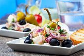 stock photo of ouzo  - closeup of a greek salad of grilled octopus