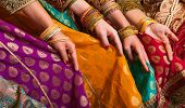 stock photo of indian sari  - Bollywood dancers are holding their vivid costumes - JPG