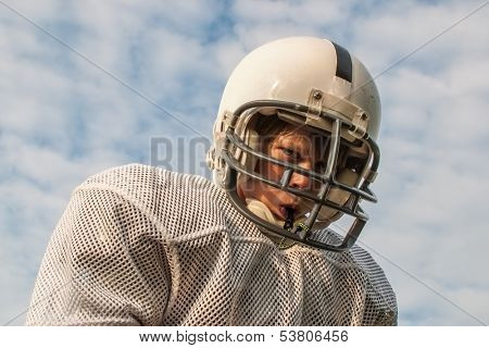 Young boy in football helmet