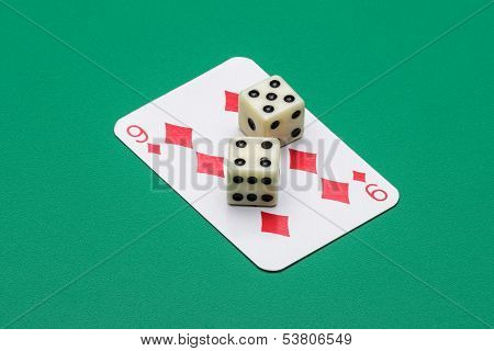 Nine of diamonds and two dice with the same number drawn