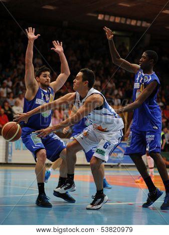 KAPOSVAR, HUNGARY �¢�?�? OCTOBER 26: Kornel Kiss (in white) in action at a Hungarian Championship basketball game with Kaposvar (white) vs. Fehervar (blue) on October 26, 2013 in Kaposvar, Hungary.