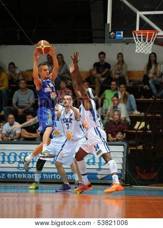 KAPOSVAR, HUNGARY �¢�?�? OCTOBER 26: Wayne Chism (white 34) in action at a Hungarian Championship basketball game with Kaposvar (white) vs. Fehervar (blue) on October 26, 2013 in Kaposvar, Hungary.