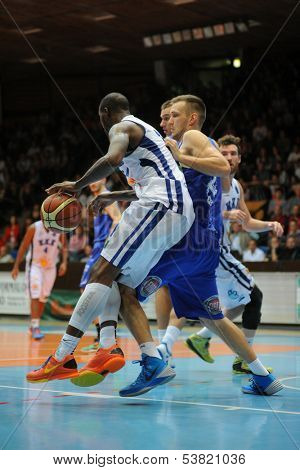 KAPOSVAR, HUNGARY �¢�?�? OCTOBER 26: Wayne Chism (in white) in action at a Hungarian Championship basketball game with Kaposvar (white) vs. Fehervar (blue) on October 26, 2013 in Kaposvar, Hungary.