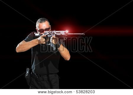 Man aiming assault rifle laser sight