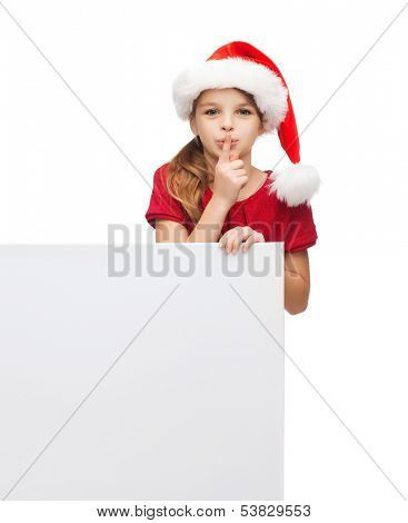 christmas, x-mas, people, advertisement, sale concept - happy girl child in santa helper hat with blank white board making shh gesture