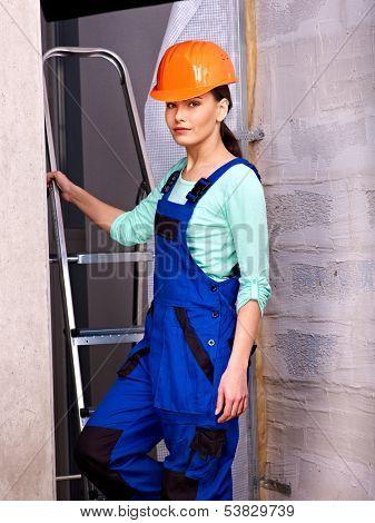 Woman in builder uniform indoor.