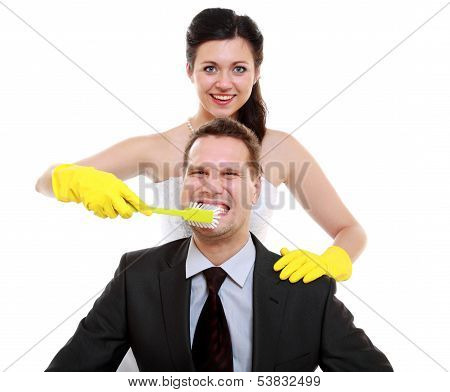 Emancipation Idea. Woman Brushing Teeth Of Her Man, Humor