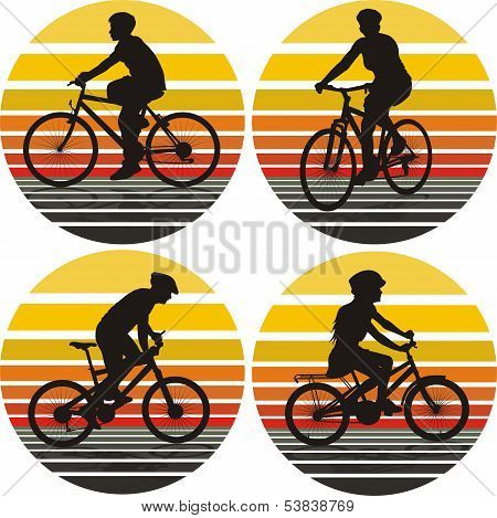 cyclists silhouettes on the background