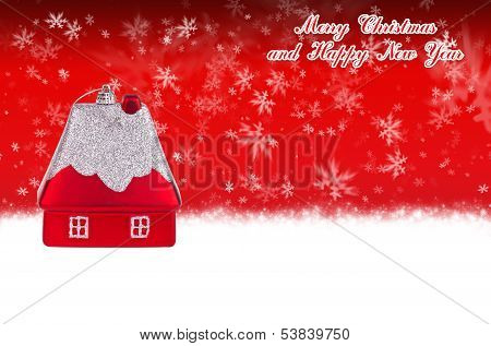 Merry Christmas And Happy New Year Red Background With Christmas Toy In The Form Of A Small House