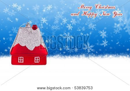Merry Christmas And Happy New Year Blue Background With Christmas Toy In The Form Of A Small House