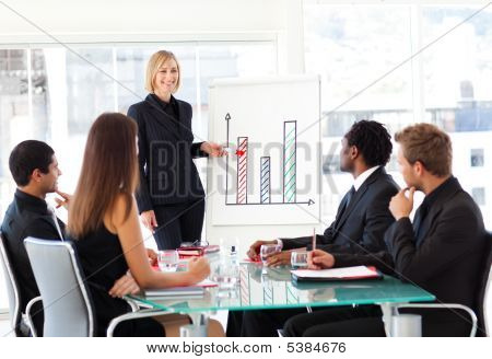 Businesswoman Reporting To Sales In A Seminar