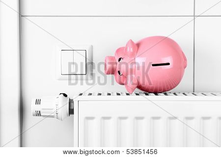 Pink Piggy Bank Saving Heating And Electricity Costs
