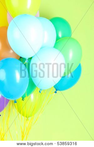 Colorful balloons on green background