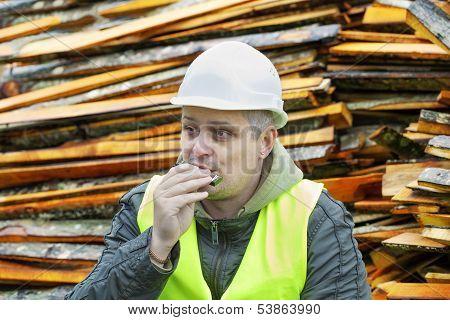 Man plays harmonica