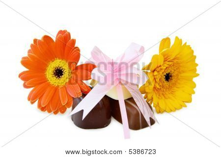 Chocolates With Flowers And Festive Bow