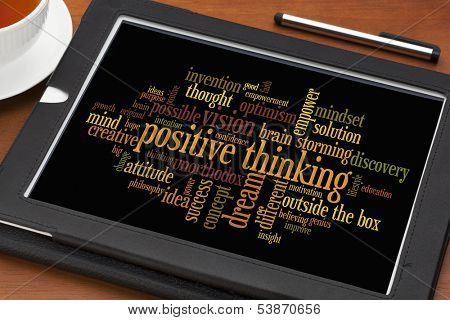 positive thinking concept - word cloud on a digital tablet with a cup of tea