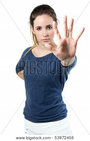 Young Woman Making Stop Sign In Front Of The Camera