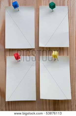 Sticky Note On A Wooden Background