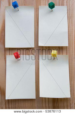 Sticky Note On A Wooden Background
