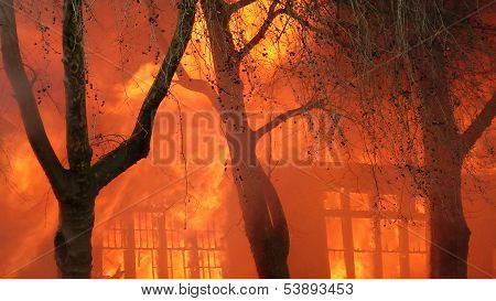 Flames Engulf Building On Fire