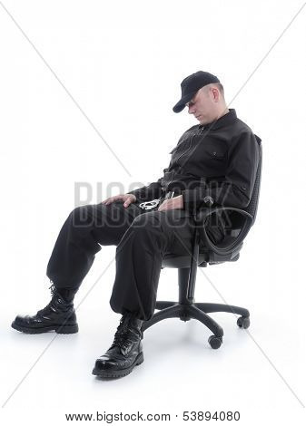 Security man sleeping on armchair shot on white