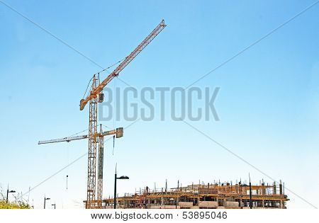Tower Cranes Working On Construction Site Of Hi-rise Building