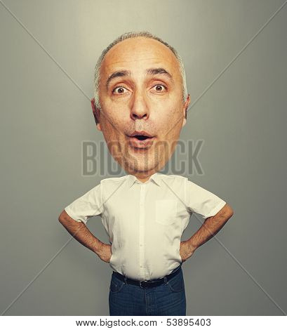 funny picture of excited senior man with big head over dark background